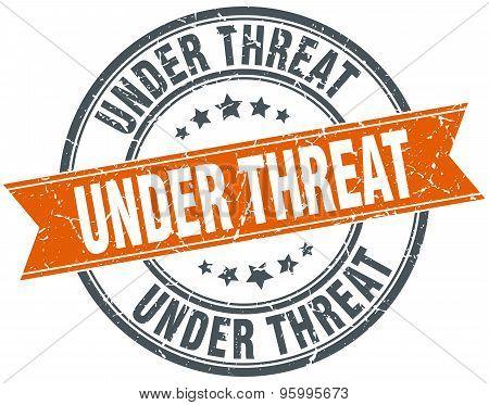 Under Threat Round Orange Grungy Vintage Isolated Stamp