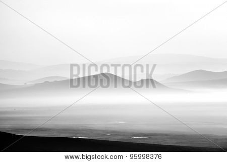 mountains in the fog,Toned black and white.