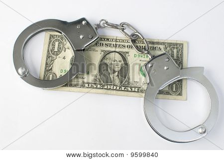 Close-up handcuffs and money