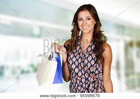 Woman shopping with bags at the mall