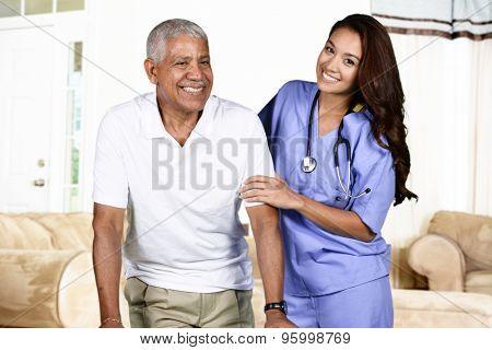 Health care worker helping an elderly man