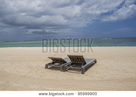 Storm Clouds Gathering Over A Tranquil Beach