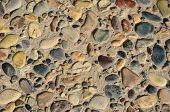 stock photo of tile  - Floor tiles paved with pebbles and stone tiles of different sizes and color - JPG