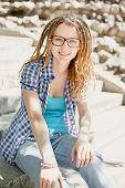 image of dreadlock  - Young stylish girl with dreadlocks outdoors - JPG