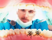 picture of visitation  - Dentist in a oral visit sees germs - JPG