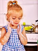 image of messy  - Child little girl with flour messy face  dough at kitchen - JPG