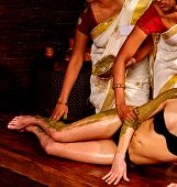 foto of panchakarma  - Young woman having legs and feet Ayurveda spa massage - JPG