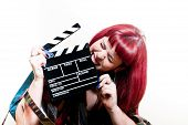 picture of mm  - Young woman biting movie clapper board with 35 mm filmstrip and white background - JPG
