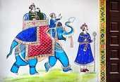 stock photo of rajasthani  - Traditional Rajasthan painting on the house wall of king riding on the blue elephant in Udaipur Rajasthan India - JPG