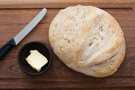 picture of home-made bread  - knife home made bread and butter on wooden board  - JPG