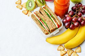 stock photo of fruits  - school lunch with a sandwich fresh fruits crackers and juice - JPG