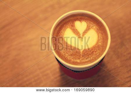 Art of latte in a takeaway cup