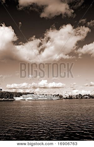 motor ship on pier. sepia