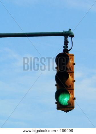 Green Traffic Light Against Blue Sky
