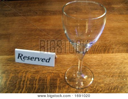 Reserved Table. Sign & Glass On A Table Of A Restaurant