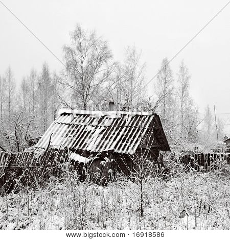 old rural house in snow