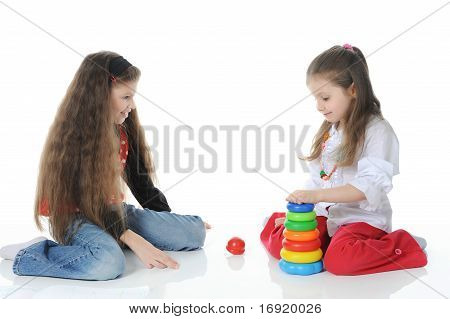 Two sisters draw play toys