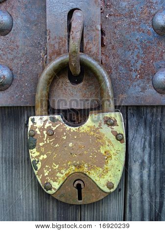 old metal lock on the wooden door