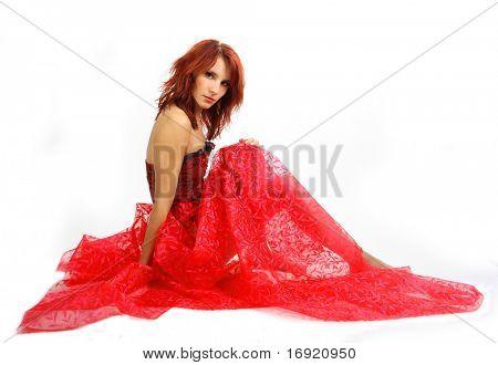 sexy rothaarige Mädchen im roten Kleid, isolated on white background