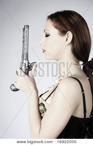 old-fashioned portrait of a beautiful girl with gun