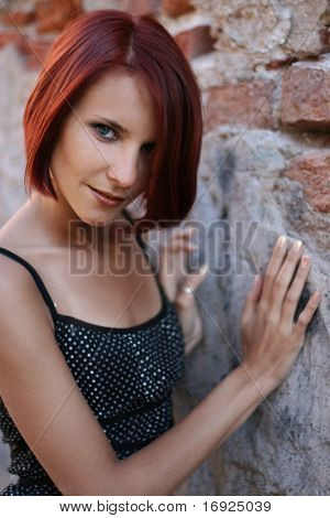 sexy young girl near old wall