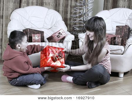 young sister and brother with christmas presents