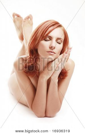 beautiful redhaired girl lying in studio
