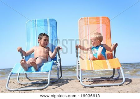 funny little couple relaxing on the beach