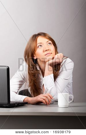 woman at office with laptop