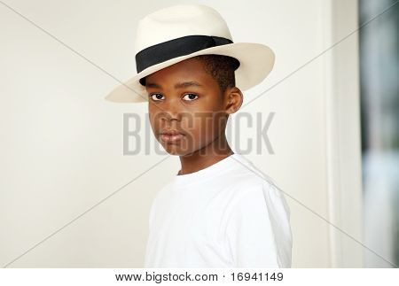 An african boy in hat
