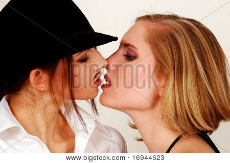 Androgynous couple kissing