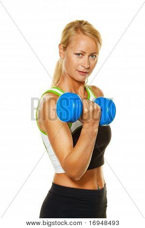 Woman with weights while training for strength