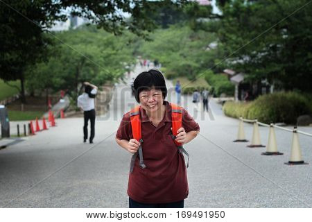 Tourists backpack orange women feel very happy. When it comes to arranging travel destination to explore.