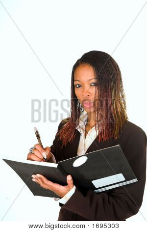 Lady Writing In Notebook