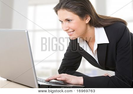 Businesswoman working on a laptop computer in an office