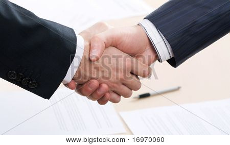 Business people joining hands together for deal