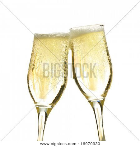 Pair of champagne flutes making a toast.