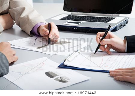 Image of business people's hands during teamwork