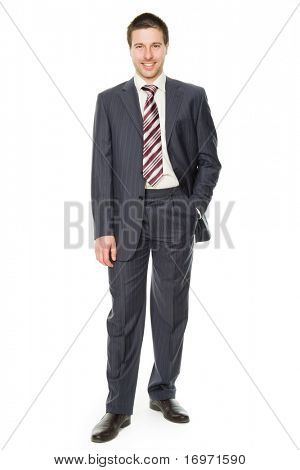 Portrait of a smiling young businessman standing against isolated white background