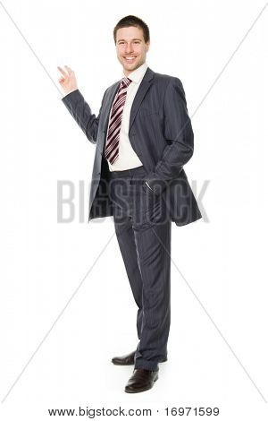 Full length portrait of a handsome businessman showing copyspace for texting - Isolated on white