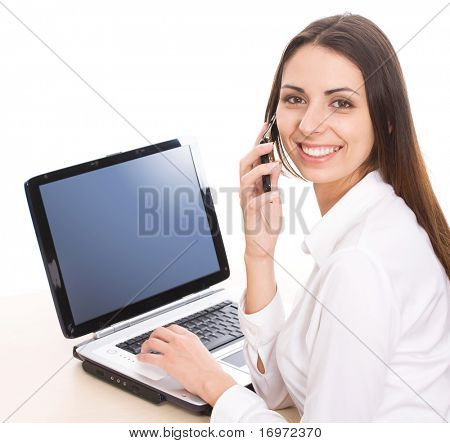 A portrait of  young businesswoman operating a lap-lop