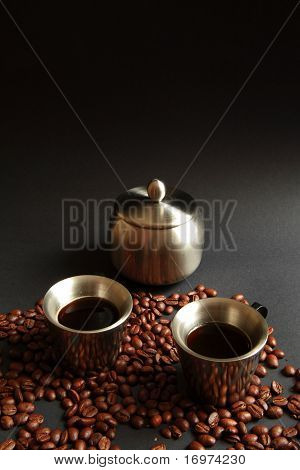 Coffee in metal cup with grain