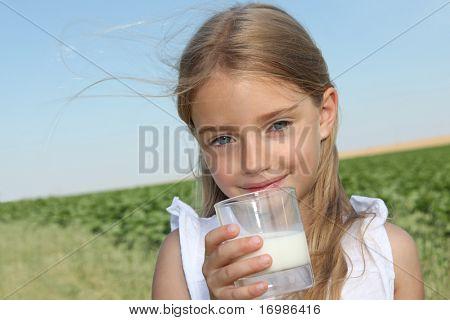 Closeup of little girl drinking milk
