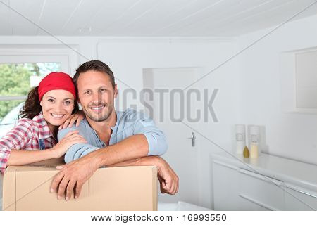 Closeup of couple resting on boxes