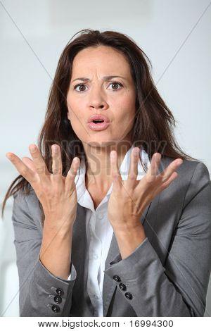 Businesswoman with misunderstanding look