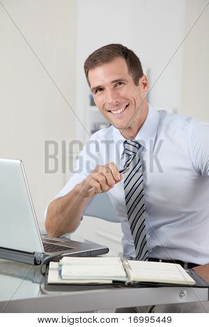 Man working in the office with laptop computer