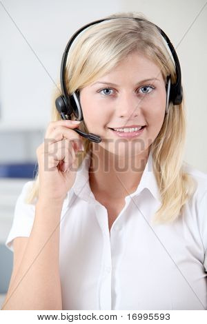 Closeup of blond woman with headphones and microphone