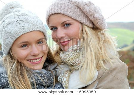 Closeup of mother and daughter in fall