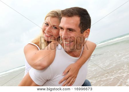 Happy couple enjoying vacation on a sandy beach