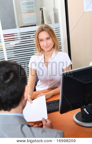 Man meeting financial adviser in office